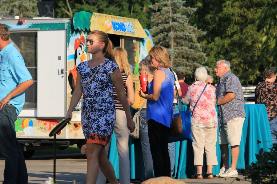 Concert attendees enjoy food from the food trucks